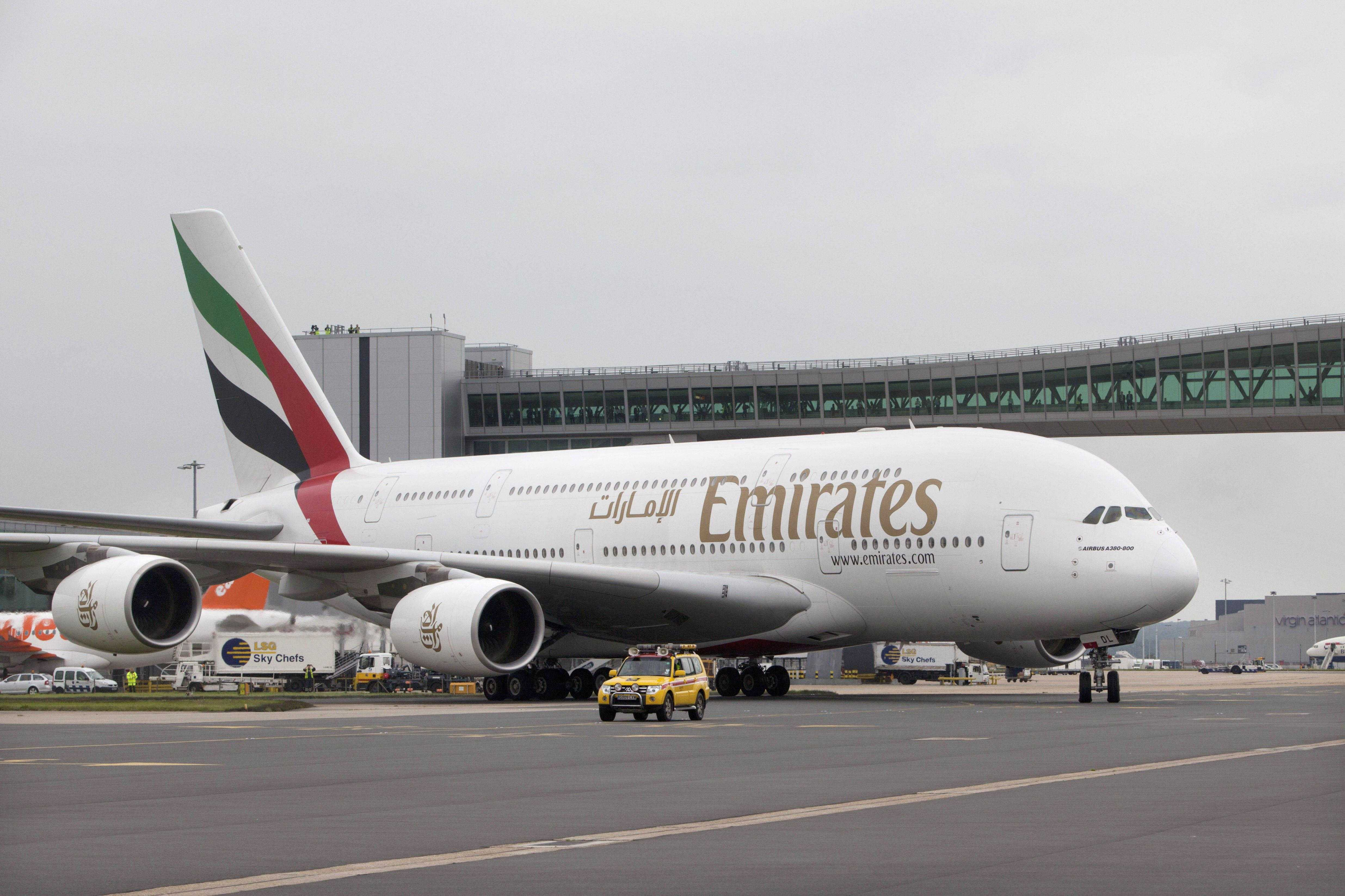 Emirates A380 in front of Pier 6 at Gatwick Airport