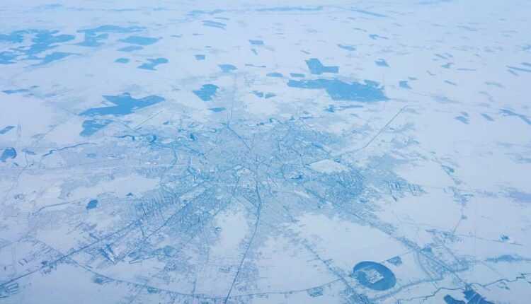 Povestea fotografiei: Bucureştiul îngheţat fotografiat de la 12 000 metri!