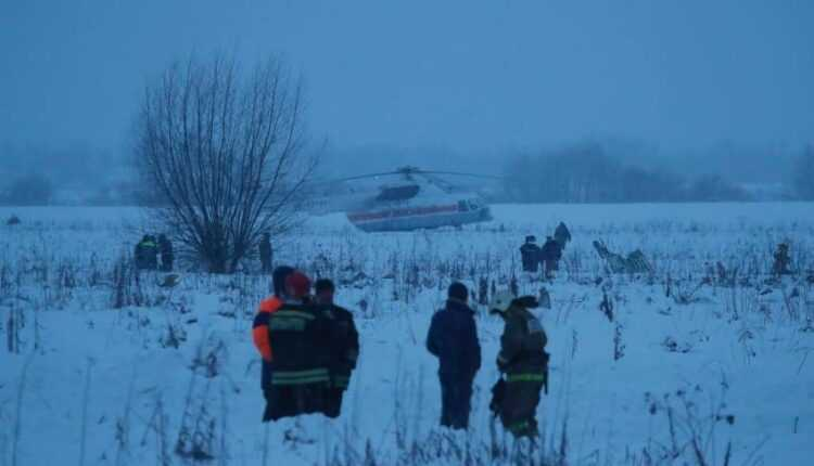 Emergency services work at the scene where a regional short-haul Antonov AN-148 plane crashed after taking off from Moscow's Domodedovo airport, outside Moscow